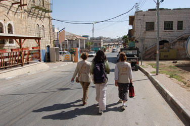 Two EAs and a coordinator in a part of Hebron inhabited by settlers