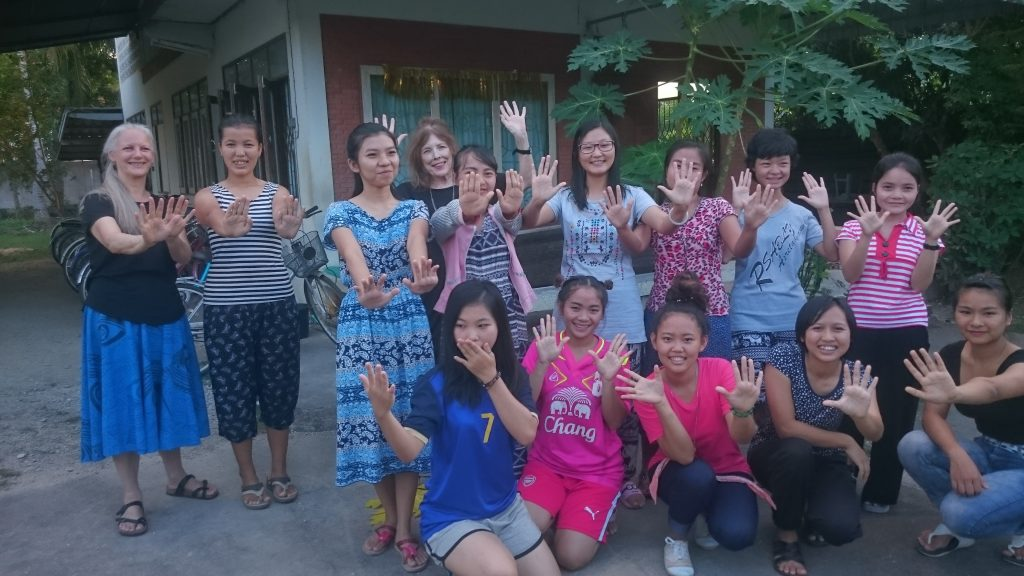 Christine with volunteer Rosaleen and her female students in Mae Sot, Thailand.