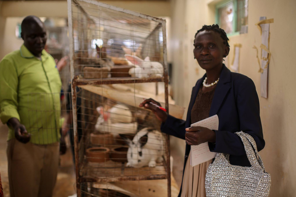 A woman inside the Ngong National Rabbit Breeding Centre