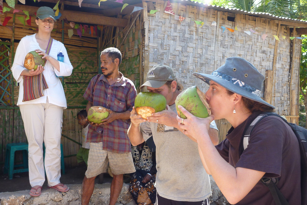 Palms Encounter participants drinking from coconuts in Timor-Leste